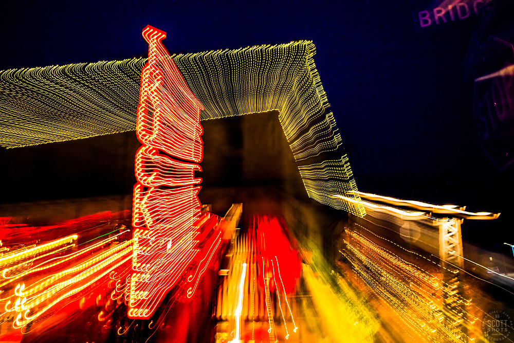 """""""Truckee Lights 1"""" - Photograph of the Truckee sign outside of Moody's Bistro Bar and Beats in Downtown Truckee, California. The abstract effect was obtained in camera by long exposure mixed with intentional camera movement."""