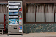 A cigarette vending machine outside an empty shop in the abandoned village of Tsushima in rural Fukushima near the exclusion zone, Fukushima Japan. Wednesday May 5th 2011. After the explosions at the Daichi nuclear plant caused by the March 11th 2011 earthquake and tsunami. High levels of radioactive contamination in this village have made it uninhabitable.