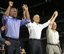 November 2, 2018 - Miami, Florida, U.S. - From left, ANDREW GILLUM, Democratic nominee for governor of Florida, former President BARACK OBAMA and U.S. Senator BILL NELSON join hands during a campaign rally in Miami at Ice Palace Films Studios on Friday. (Credit Image: © Al Diaz/Miami Herald/TNS via ZUMA Wire)