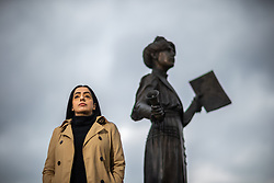 © Licensed to London News Pictures . 14/05/2021. Oldham , UK . Cllr AROOJ SHAH (pictured in front of a statue of suffragette Annie Kenney in Oldham Town Centre), who represents the Chadderton South ward on Oldham Council, has been elected as the new leader of Oldham's Labour Group and is due to be confirmed as leader of the council on 19th May 2021 . She will be the first Muslim woman to lead the council . Photo credit : Joel Goodman/LNP