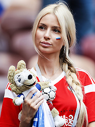 female Russian fan during the 2018 FIFA World Cup Russia round of 16 match between Spain and Russia at the Luzhniki Stadium on July 01, 2018 in Moscow, Russia