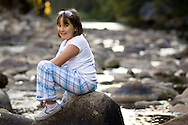 A young girl sits on rocks in the Merced River in Yosemite National Park on Saturday, Sept. 29, 2007. (Photo by Kevin Bartram)