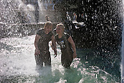 Moscow, Russia, 20/05/2007..Teenagers cool off in fountains on Manezh Square by the Kremlin during a heatwave.