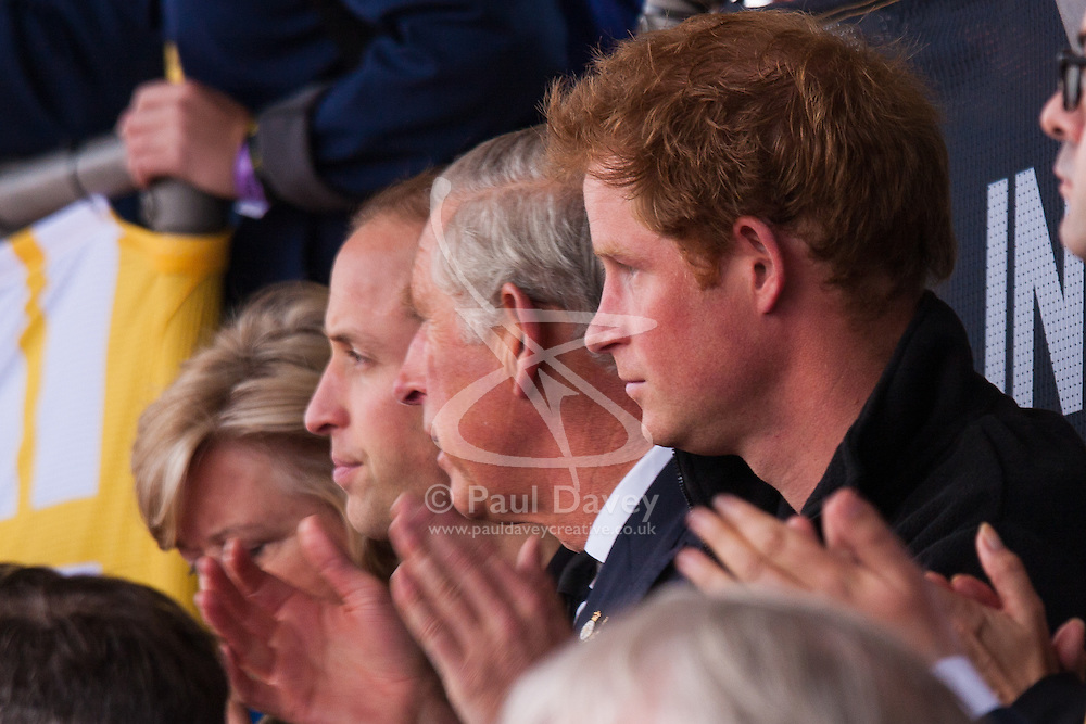 Lee Valley Athletic Centre, London, September 11th 2014. Prince charles is flanked by his two sons, Prince William and Harry as they enjoy the action at the Invictus Games track and field competition.