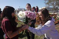 Alexandra Rozenblat, left, Melena Plough, second from left, and Lily Lafayette arrive with flowers for the memorial garden outside Marjory Stoneman Douglas High School in Parkland, Fla. on Wednesday, February 14, 2019, on the anniversary of the shooting at the school. The girls are juniors at the school. Photo by Joe Cavaretta/Sun Sentinel/TNS/ABACAPRESS.COM