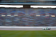Kyle Busch (18) takes the lead during the Sprint Cup NRA 500 at Texas Motor Speedway in Fort Worth on Saturday, April 13, 2013. (Cooper Neill/The Dallas Morning News)