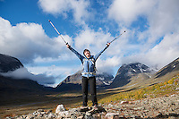 Female hiker with mountains in distance, Ladtjovagge, near Kebnekaise Fjällstation, Lappland, Sweden