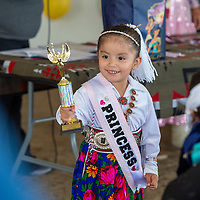 Reese Garcia, 3, beams with pride as she wins first place in the baby contest at the Eastern Navajo Fair Friday in Crownpoint, New Mexico.