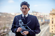 Franz Kafka lookalike Marek Lentvorsky (21) with the finished model of the insect body by Gregor Samsa portrayed on a balcony of the Goethe Institut.