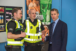 Pictured: Michael Matheson meets PC Ross Munro (l) and Gordon Currie (r)<br /> Today, Justice Secretary Michael Matheson visited the Raploch community campus and met young people involved in CashBack-funded basketball sessions. <br />  <br /> Ger Harley   EEm 11 July  2017