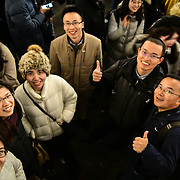 A group of Chinese Attendees the Regent Street Christmas Lights switch-on celebrate its 200th anniversary on 14 November 2019, London, UK.