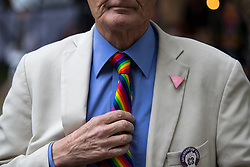 © Licensed to London News Pictures . 25/08/2017. Manchester , UK. ANDREW LUMSDEN (76) straightens his rainbow tie . Andrew was at the first ever Gay Pride in Manchester. The opening night of Manchester Pride's Big Weekend . The annual festival , which is the largest of its type in Europe , celebrates LGBT life . Photo credit: Joel Goodman/LNP