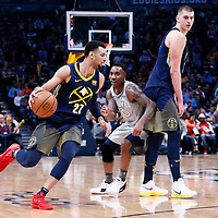 05 April 2018: Denver Nuggets guard Jamal Murray (27) drives past Minnesota Timberwolves guard Jeff Teague (0) on a screen set by Denver Nuggets center Nikola Jokic (15) during the Denver Nuggets 100-96 victory over the Minnesota Timberwolves, at the Pepsi Center, Denver, Colorado, USA.