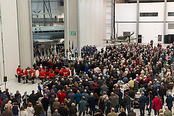 © Licensed to London News Pictures. 08/11/2015. Duxford, UK. An official service of Remembrance and wreath laying ceremony taking place in front of a spitfire plane at Imperial War Museum Duxford, Cambridgeshire on Remembrance Sunday 2015. . Photo credit: Ben Cawthra/LNP