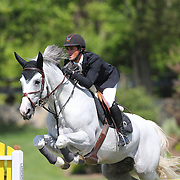 Nicholas Dello Joio riding Caballero 80 in action during the $100,000 Empire State Grand Prix presented by the Kincade Group during the Old Salem Farm Spring Horse Show, North Salem, New York,  USA. 17th May 2015. Photo Tim Clayton