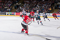 KELOWNA, CANADA - APRIL 14: Henri Jokiharju #16 of the Portland Winterhawks takes a shot against the Kelowna Rockets on April 14, 2017 at Prospera Place in Kelowna, British Columbia, Canada.  (Photo by Marissa Baecker/Shoot the Breeze)  *** Local Caption ***