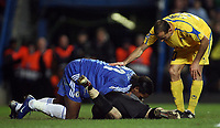 Photo: Paul Thomas.<br /> Chelsea v Levski Sofia. UEFA Champions League, Group A. 05/12/2006. <br /> <br /> Didier Drogba (Blue) of Chelsea checks to see if Keeper Bozhidar Mitrev (C) is okay after they collide.