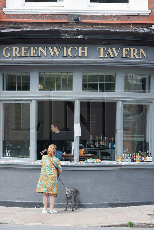 ©Licensed to London News Pictures 15/06/2020<br /> Greenwich, UK. Greenwich Tavern pub window bar. People out and about in Greenwich park, Greenwich, London enjoying the warm sunny weather and Coronavirus lockdown freedom. Photo credit: Grant Falvey/LNP