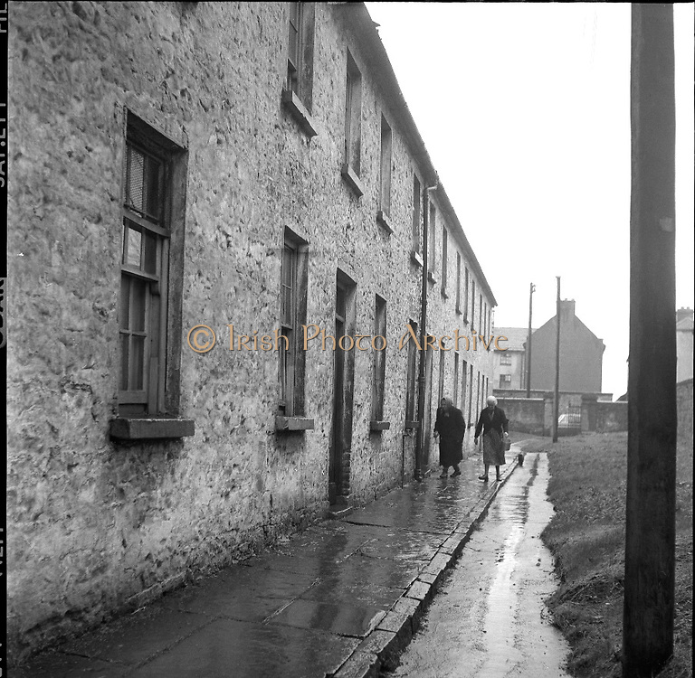 Limerick Widows Alms House. Widows Kate O'Riordan (left) and Mary Kelly outside the white-washed Alms House..28.03.1962