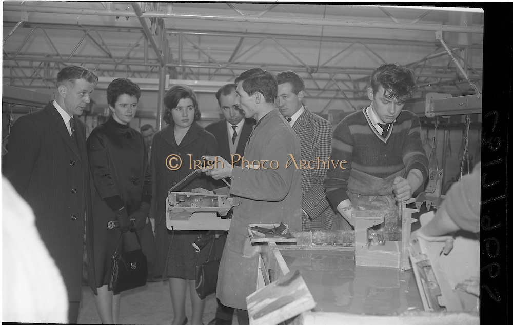 07/02/1964<br /> 02/07/1964<br /> 07 February 1964<br /> Tour of Brother International Factory at Santry, Co. Dublin. Included are Mr J. Duane (Arnotts); Miss M. Connolly (Boyers); Miss J. McGarry (Queens OLD Castle, Cork); Mr C.J. Magian, (Sewing Machine Centre); Mr E. Roche (Arnotts) and Foreman,  John Malone in the Paint Shop.
