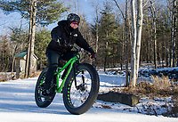 """Sonya Misiaszek gets in a """"lunch hour"""" workout on her fat bike with Kale Poland at Gunstock Nordic on Thursday.  (Karen Bobotas/for the Laconia Daily Sun)"""
