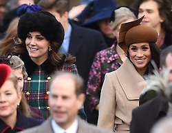The Duchess of Cambridge (left) and Meghan Markle arriving to attend the Christmas Day morning church service at St Mary Magdalene Church in Sandringham, Norfolk.