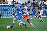 Peterborough United midfielder Marcus Maddison (21) takes on Blackpool defender Curtis Tilt (16)  during the EFL Sky Bet League 1 match between Peterborough United and Blackpool at The Abax Stadium, Peterborough, England on 29 September 2018.