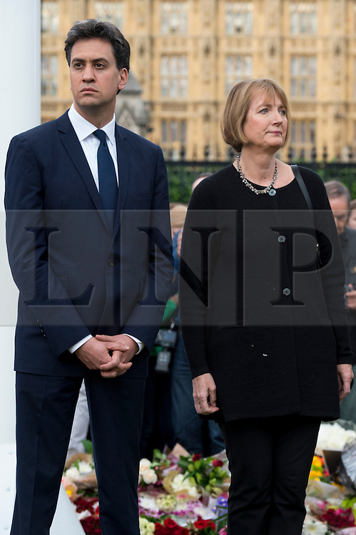© Licensed to London News Pictures. 17/06/2016. Labour party politicians ED MILLIBAND and HARRIET HARMAN  attend vigil and observe a two minutes silence with well wishers in Parliament Square in memory of Labour party MP JO COX. She was allegedly attacked and killed by suspect 52 year old Tommy Mair close to Birstall Library near Leeds. London, UK. Photo credit: Ray Tang/LNP