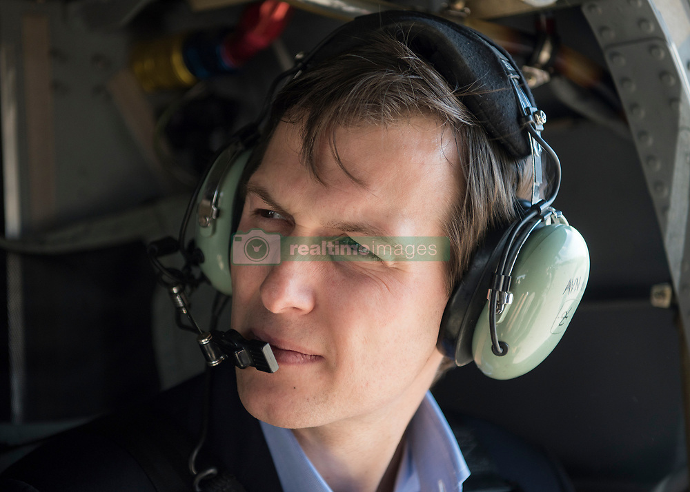 April 3, 2017 - Baghdad, Iraq - Jared Kushner, Senior Advisor and son-in-law to President Trump, listens to U.S. Joint Chief of Staff Chairman Gen. Joseph Dunford during helicopter ride aboard a CH-47 on arrival to Iraq April 3, 2017 in Baghdad, Iraq. (Credit Image: © Dominique A. Pineiro/Planet Pix via ZUMA Wire)