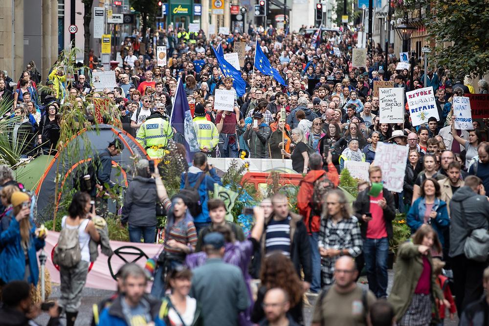 © Licensed to London News Pictures. 31/08/2019. Manchester, UK. Thousands attend a pro EU demo in Manchester City Centre and march en masse along John Dalton Street to join an Extinction Rebellion occupation of Deansgate . Objections are being raised about the Prime Minister Boris Johnson's intention to prorogue Parliament in the run up to Britain's planned Brexit deadline . Photo credit: Joel Goodman/LNP