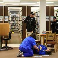 (Left to right) Gallup police officers Darris Johnson, Patrick Largo and Dewayne Holder find victims as they sweep the library during the active shooter drill Thursday morning at the Octavia Fellin Public Library.