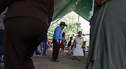 In this July 23, 2016 photo, wedding attendees dance in a circle, around newlyweds Pablo Ibarra, 75, and Francisca Santiago, 65, in Santa Ana, in the Mexican state of Oaxaca. The couple has been together for 46 years, but the town's church just recently agreed to allow a religious marriage, as Ibarra's divorce from long ago from his first wife, delayed the process. NICK WAGNER / ASSOCIATED PRESS
