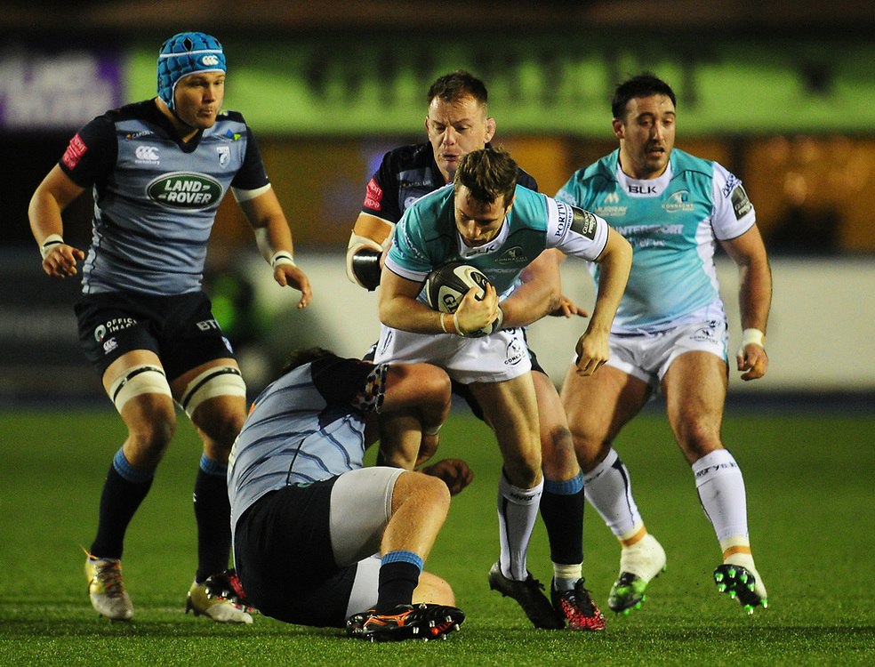 Connacht's Jack Carty is tackled by Cardiff Blues' Corey Domachowski<br /> <br /> Photographer Kevin Barnes/CameraSport<br /> <br /> Guinness Pro14 Round 9 - Cardiff Blues v Connacht Rugby - Friday 24th November 2017 - Cardiff Arms Park - Cardiff<br /> <br /> World Copyright © 2017 CameraSport. All rights reserved. 43 Linden Ave. Countesthorpe. Leicester. England. LE8 5PG - Tel: +44 (0) 116 277 4147 - admin@camerasport.com - www.camerasport.com