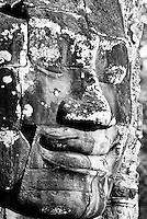 The smiling face of the bodhisattva Avalokiteshvara at The Bayon temple in the walled city of Angkor Thom, Siem Reap, Cambodia
