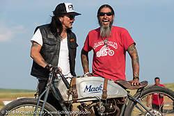 Musicians Gilby Clarke and Xavier Muriel at the Sons of Speed races during the 78th annual Sturgis Motorcycle Rally. Sturgis, SD. USA. Thursday August 9, 2018. Photography ©2018 Michael Lichter.