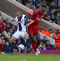 Photo: Dave Linney.<br />West Bromwich Albion v Liverpool. The Barclays Premiership. 01/04/2006West Brom;s .Ronniw Wallwork (L)  battles for the ball withMomo Sissoko