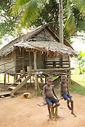 Children sat on bench in Togum Village, Lake Murray, Middle Fly District, Western Province, Papua New Guinea