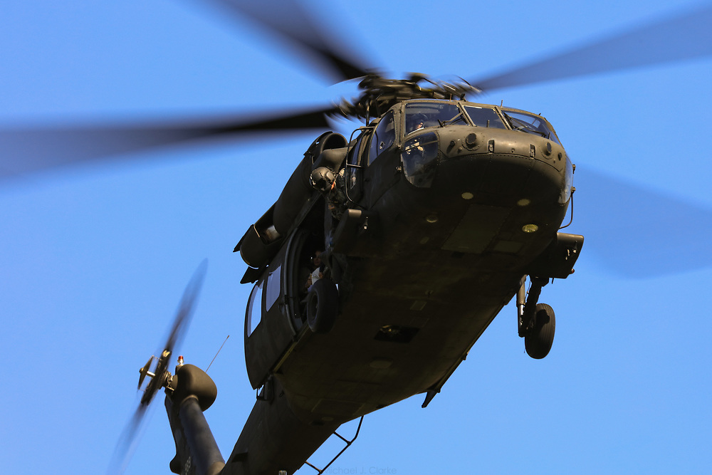 A US Army Blackhawk helicopter cruising in for a landing on Boston Common while delivering Medal of Honor recipients to the downtown area.