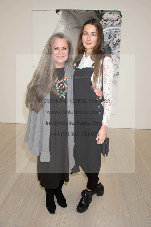 KOO STARK and her daughter TATIANA WALKER at the opening of the exhibition Champagne Life in celebration of 30 years of The Saatchi Gallery, held on 12th January 2016 at The Saatchi Gallery, Duke Of York's HQ, King's Rd, London.