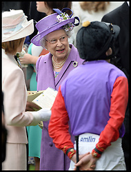 The Queen chats to her winning jockey Ryan Moore  in the parade ring. As the Queens winning horse Estimate wins the Gold Cup with her horse at Royal Ascot 2013 Ascot, United Kingdom,<br /> Thursday, 20th June 2013<br /> Picture by Andrew Parsons / i-Images