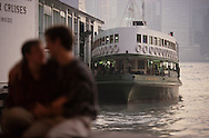 The romance of the Star Ferry in Hong Kong.  Photograph made for a book project on Ferryboats..Photograph by Dennis Brack bb24