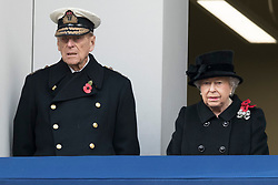 © Licensed to London News Pictures. 12/11/2017. London, UK.  The DUKE OF EDINBURGH and HRH QUEEN ELIZABETH II attend a Day Ceremony at the Cenotaph war memorial in London, United Kingdom, on November 13, 2016 . Thousands of people honour the war dead by gathering at the iconic memorial to lay wreaths and observe two minutes silence. Photo credit: Ray Tang/LNP