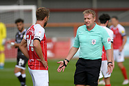 Referee Trevor Kettle, who sent off Crawley Town Head Coach John Yems after the final whistle talks to Andy Williams (14) of Cheltenham Town during the EFL Sky Bet League 2 match between Cheltenham Town and Crawley Town at Jonny Rocks Stadium, Cheltenham, England on 10 October 2020.