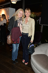 Left to right, TINE STEINCKE and DEBBIE LENG at a party to celebrate the Astley Clarke & Theirworld Charitable Partnership held at Mondrian London, Upper Ground, London on 10th March 2015.