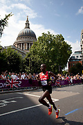 London, UK. Sunday 12th August 2012. Men's marathon competitors pass St Pauls Cathedral through the City of London, the last of the track and field competitions in the London 2012 Olympics.