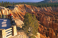 Tourists overlook at the rim of Bryce Canyon, Bryce Canyon National Park, Utah
