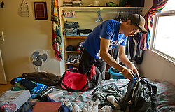 Damian Kailek, 24,  prepares  for an expedition into the Thelon Sanctuary in his home of Lutsel Ke' (aka Snowdrift) July 21, 2011 in the Northwest Territories of Canada.