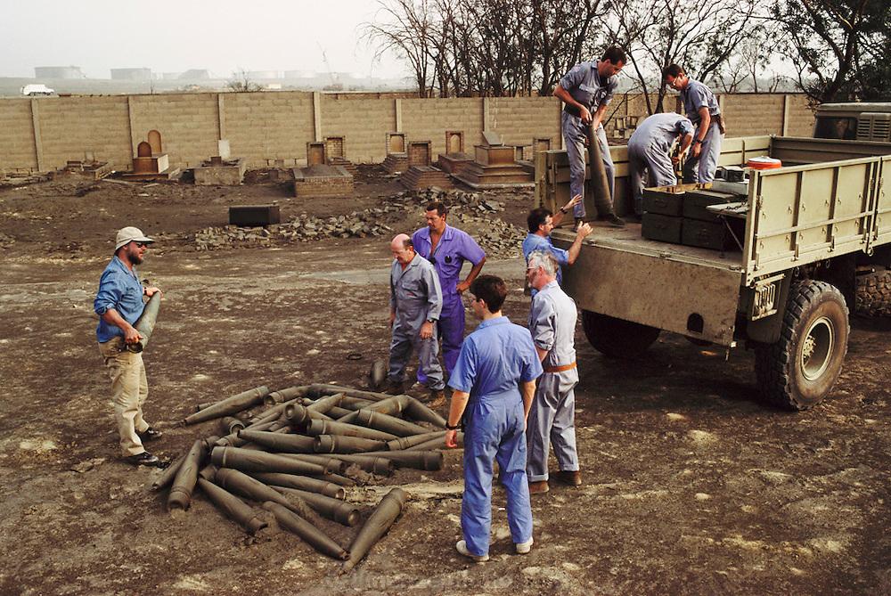 Kuwait: Ahmadi Moslem graveyard; British explosive ordnance disposal team loading Iraqi arms/ordnance.