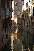 A lovely Venice canal with a bridge and reflections in the water