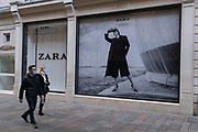Shoppers walk past the Zara retailer in Knightsbridge during the second Coronavirus lockdow when most non-essential retailers and small businesses remain closed by order of the government, on 13th November 2020, in London, England.